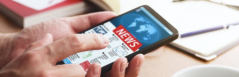 Person reading AllWays Insider news on mobile phone