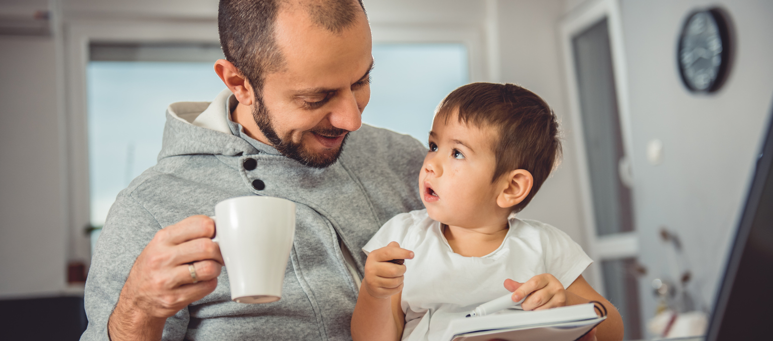 father working at home with child