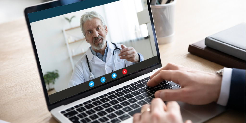 Male patient talks with doctor on video call