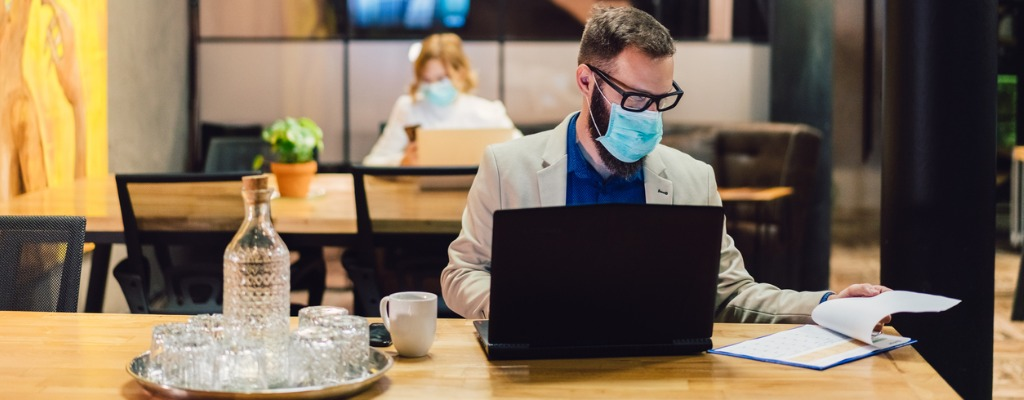 Businesspeople wearing masks in the office