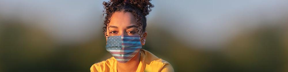 girl wearing American flag mask