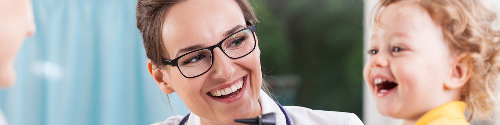 doctor with glasses smiling