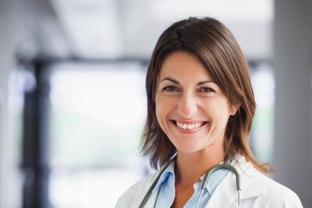 smiling female doctor wearing lab coat