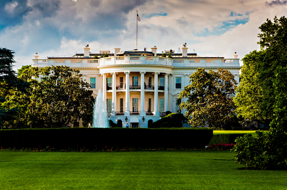 the white house in front of a green lawn