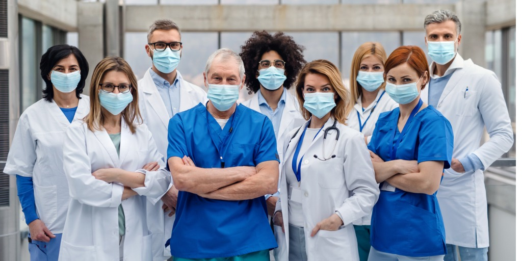 group-of-doctors-with-face-masks-looking-at-camera