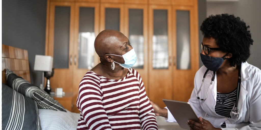 health-visitor-and-a-senior-woman-during-nursing-home-visit