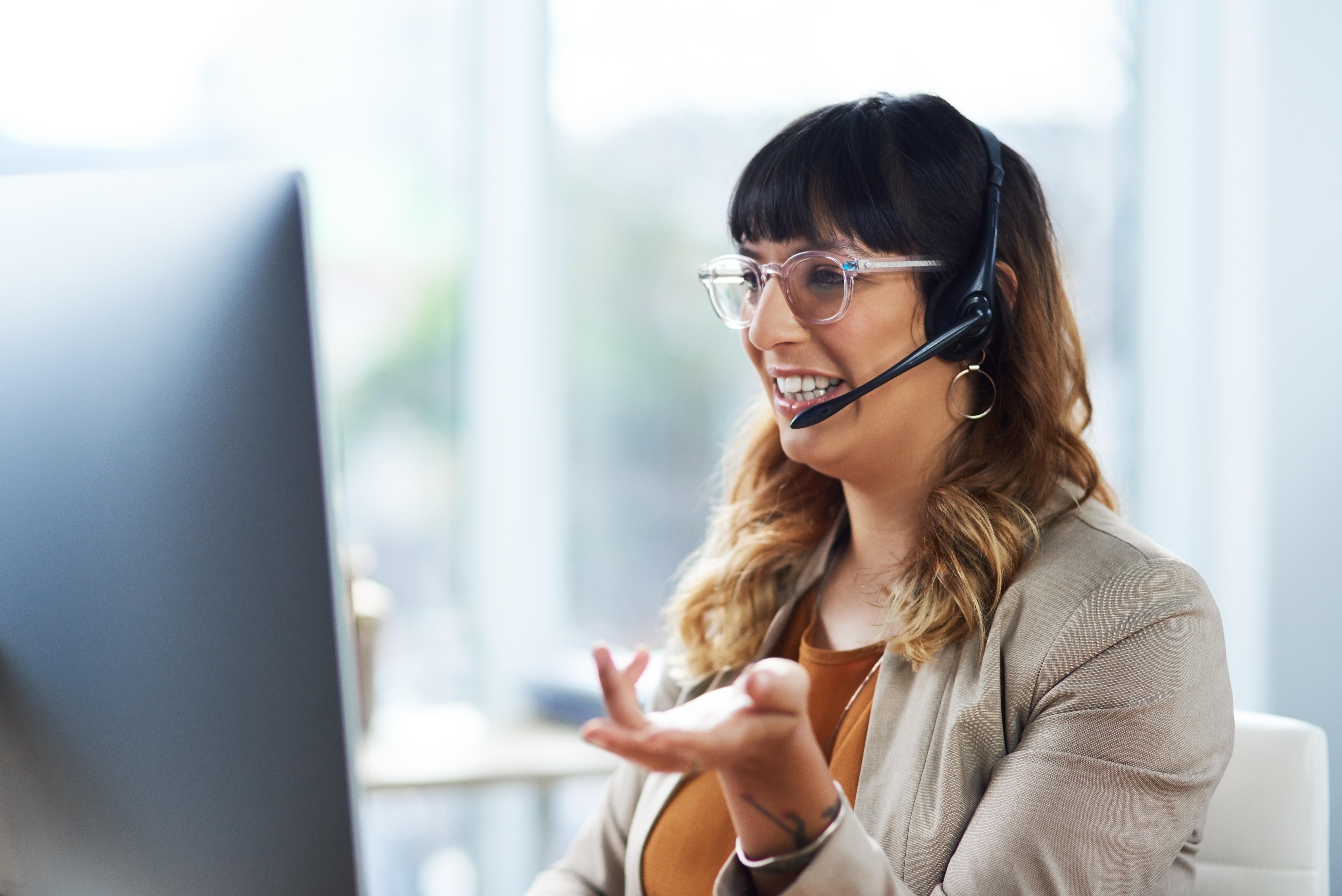 customer service representative wear headset with a smile