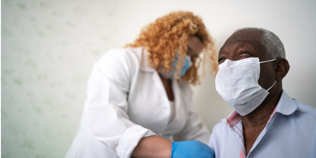 doctor injecting patient with vaccine