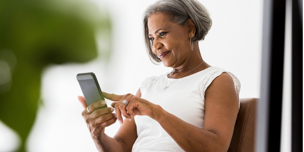 smiling woman looking at her phone